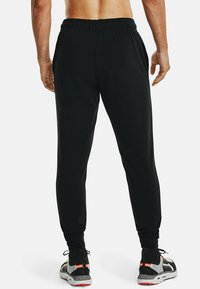 Under Armour - RIVAL TERRY  - Tracksuit bottoms - black - 2