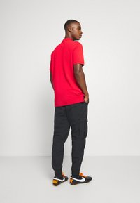 Nike Performance - FC LIVERPOOL PANT - Tracksuit bottoms - black/hyper turquoise/university red - 2