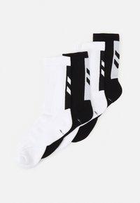 Hummel - LEGACY CHEVRON SOCKS MIX 4 PACK UNISEX - Sports socks - white/black - 0
