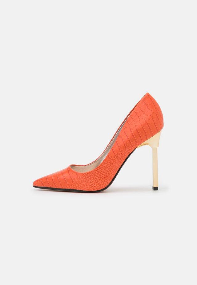 Klassieke pumps - orange