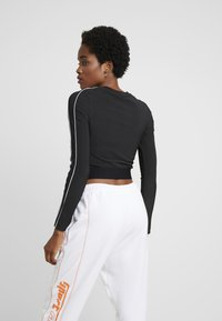 Puma - CLASSICS - Long sleeved top - black - 2