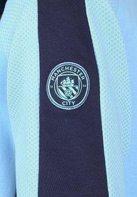 Puma - MANCHESTER CITY EVOSTRIPE - Squadra - team light blue / peacoat - 2