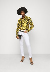 Versace Jeans Couture - Jeans Skinny Fit - optical white - 1