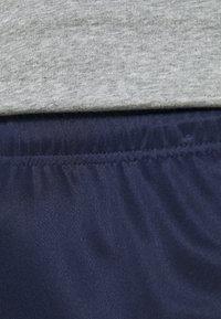 Puma - TEAMLIGA TRAINING PANTS - Jogginghose - peacoat/white - 3