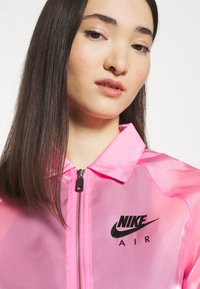 Nike Sportswear - AIR SHEEN - Summer jacket - pink glow/black - 4