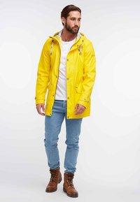 Schmuddelwedda - ANORAK - Waterproof jacket - yellow - 1