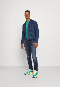 Replay - ANBASS HYPERFLEX REUSED X LITE - Jeans Tapered Fit - dark blue denim - 1