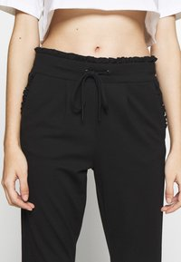 ONLY Petite - ONLPOPTRASH EASY FRILL PANT - Trousers - black - 5
