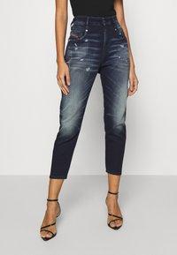 Diesel - D-FAYZA-NEJOGGJEANS - Relaxed fit jeans - indigo - 0