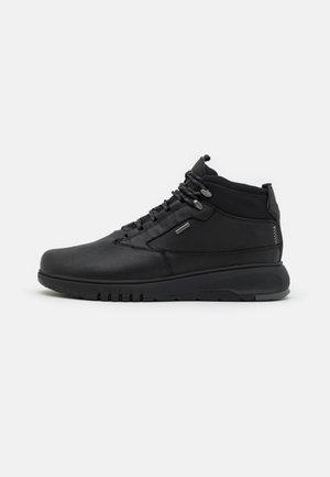 AERANTIS 4X4 ABX - Lace-up ankle boots - black