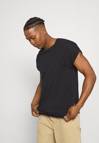 YOURTURN - UNISEX - Basic T-shirt - black - 3