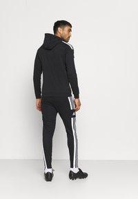 adidas Performance - SQUAD - Tracksuit bottoms - black/white - 2