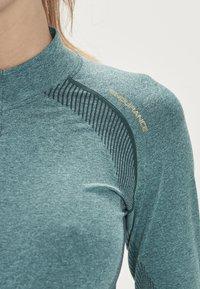 Endurance - HALEN W SEAMLESS - Sports shirt - ponderosa pine - 5