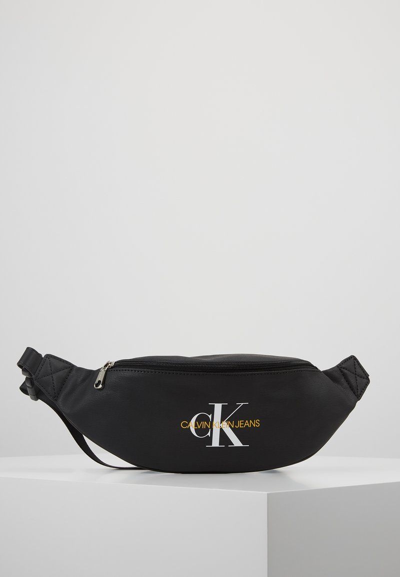 Calvin Klein Jeans - COATED ROUND STREET PACK - Bum bag - black