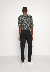 Opus - ELENI - Pantalones - black - 2