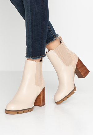 High heeled ankle boots - ecru