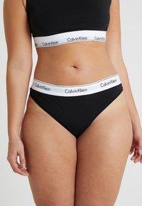 Calvin Klein Underwear - MODERN PLUS THONG - Thong - black - 0