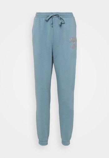 BRANDED PANT - Pantalones deportivos - blue