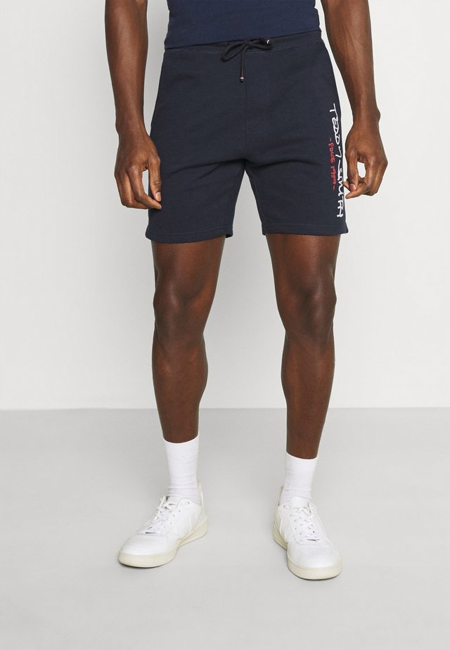 MICKAEL - Tracksuit bottoms - total navy
