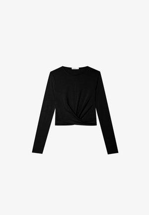 IN WICKELOPTIK - Long sleeved top - black