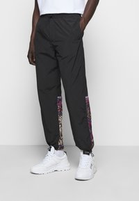 Versace Jeans Couture - CRINKLE  - Tracksuit bottoms - nero - 0