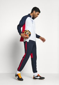Nike Performance - DRY ACADEMY PANT - Tracksuit bottoms - obsidian/university red/white - 1