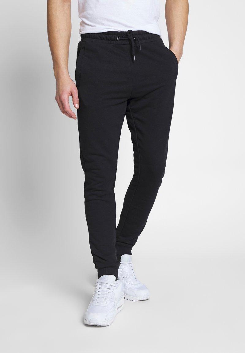 Fila - EDAN PANTS - Träningsbyxor - black