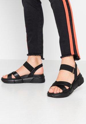 ROLLY - Platform sandals - black