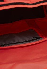 Nike Performance - TEAM DUFFLE - Sports bag - laser crimson/black/white - 3