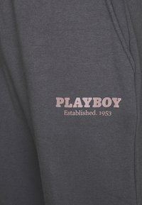 Mennace - PLAYBOY UNISEX - Tracksuit bottoms - brown - 2