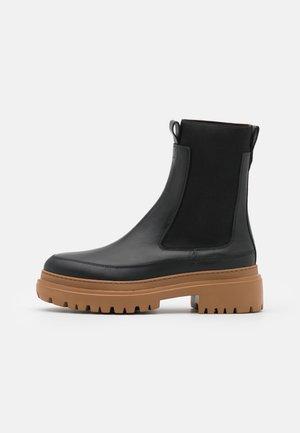 ANKLE BOOTS - Platform ankle boots - black