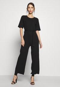 Even&Odd - BASIC - Ribbed short sleeves belted jumpsuit - Jumpsuit - black - 0