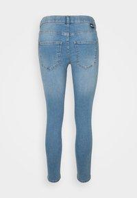 Dr.Denim Petite - PLENTY - Jeans Skinny Fit - storm light blue ripped - 1
