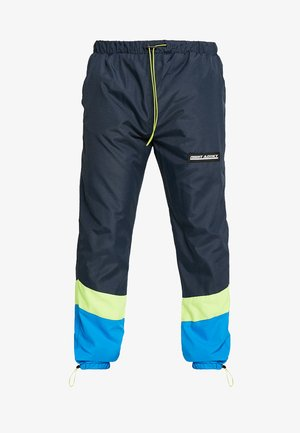 NARUSS - Tracksuit bottoms - navy/neon yellow