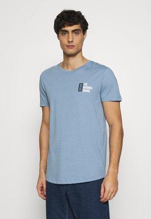 CHESTPRINT - Print T-shirt - light blue indigo