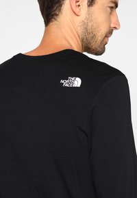 The North Face - SIMPLE DOME - Bluzka z długim rękawem - black - 4