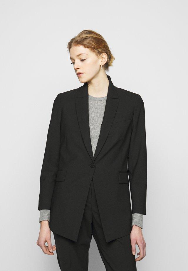 ETIENNETTE - Halflange jas - black