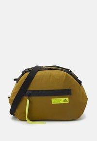 adidas Performance - FAV DUFFEL BAG - Sports bag - wild moss/acid yellow - 1