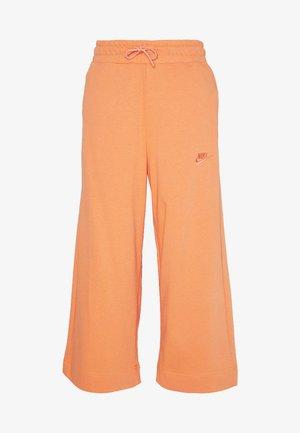 W NSW CAPRI JRSY - Pantalones deportivos - orange trance