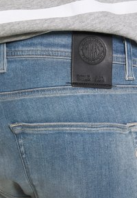 Replay - HYPERFLEX - Denim shorts - medium blue - 4