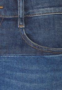 Diesel - D-EBBEY-GO - Flared Jeans - medium blue - 2