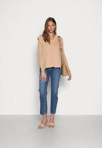 Nudie Jeans - STRAIGHT SALLY INDIGO AUTUMN - Straight leg jeans - indigo autumn - 1