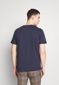 Makia - SQUARE POCKET - Basic T-shirt - dark blue - 2