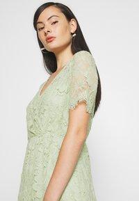 Vero Moda - VMSOFIE CALF  DRESS - Cocktailklänning - laurel green - 3