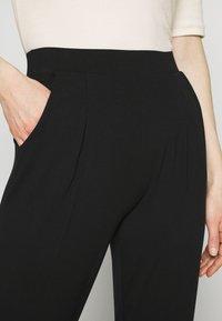 Marks & Spencer London - PLAIN TAP - Trousers - black - 4