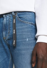 Versace Jeans Couture - DRILL - Slim fit jeans - light-blue denim - 5