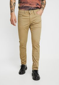 Levi's® - 512™ SLIM TAPER FIT - Tygbyxor - harvest gold - 0