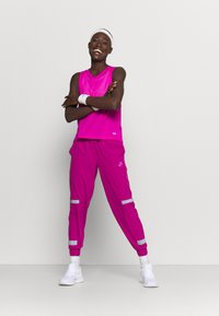 Under Armour - MUSCLE TANK - Funktionsshirt - meteor pink - 1