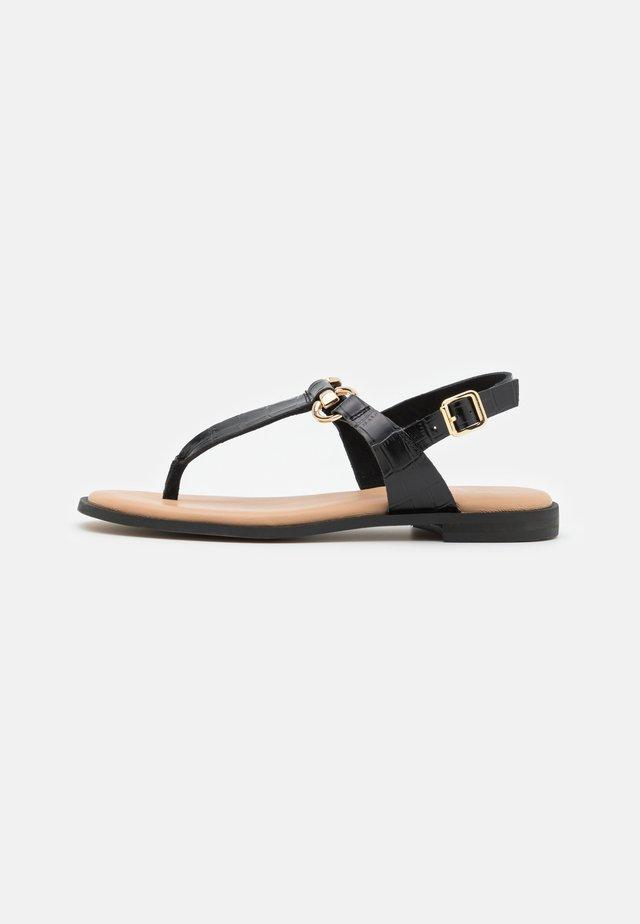 LIMBA - T-bar sandals - black