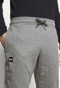 Under Armour - RIVAL - Tracksuit bottoms - pitch gray light heather - 4